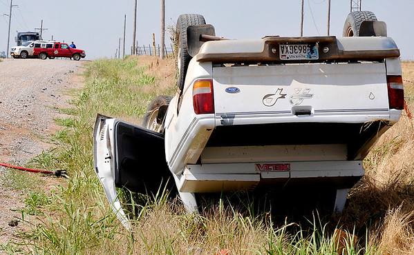 A Ford pickup rest on it's top along 30th Street south of Lake Hellums Road Thursday. (Staff Photo by BILLY HEFTON)