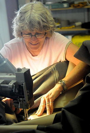 Marilyn Hawkins, owner of Derrick Canvas, stitches a cover for a large pontoon boat at 1006 Kline Wednesday, June 12, 2013. (Staff Photo by BONNIE VCULEK)