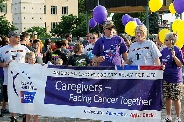 The Camo Crew (from left) Chris Walker, Zoe Walker, J.T. Beall and Jessica Walker prepare for the start of the Relay for Life Cancer Survivors victory lap Friday, June 8, 2013. J.T. Beall was diagnosed with a brain tumor last December. (Staff Photo by BONNIE VCULEK)