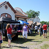Shoppers look for fresh produce, meats, baked goods and craft items at Enid Farmers Market Saturday, June 1, 2013. (Staff Photo by BONNIE VCULEK)