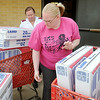 Capt. Debbie Hull (back left) and Brittany McDowell accept delivery of fifty Lasko 20 inch box fans at the Salvation Army Wednesday, June 25, 2014. OG&E donates 1,000 fans each year across Oklahoma. Jay Don Hofen and Troy Cowley, from the OG&E office in Enid, delivered the fans to the local Salvation Army before taking an additional fifty to Alva. (Staff Photo by BONNIE VCULEK)