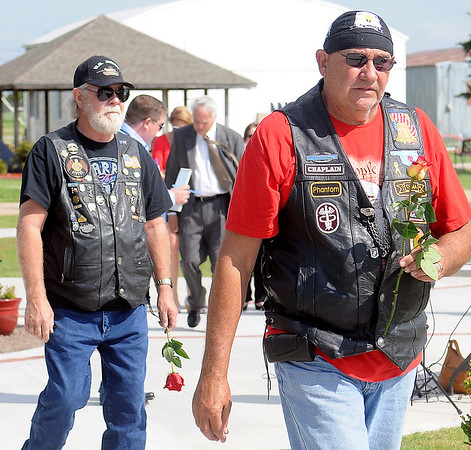 "Vietnam Veterans carry roses to honor fallen heroes during the ""In Memory"" Celebration at the Vietnam Memorial Wall Saturday, June 14, 2014. (Staff Photo by BONNIE VCULEK)"
