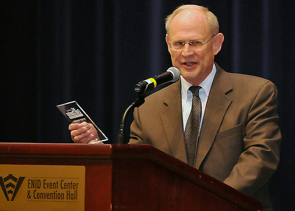 Dick McKnight addresses the audience after being named Citizen of the Year at the Enid Chamber of Commerce Annual Meeting & Banquet Thursday at Convention Hall. (Staff Photo by BILLY HEFTON)