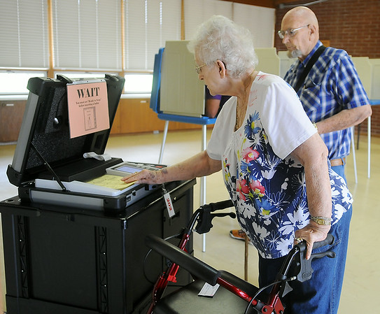 Two registered Republican voters cast their ballots at Precinct 202 inside Redeemer Lutheran Church during the Oklahoma Primary Election Tuesday, June 24, 2014. (Staff Photo by BONNIE VCULEK)