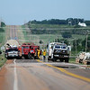 Oklahoma Highway Patrol, Oklahoma Medical Examiner, Grant County Sheriff Department, and rural firefighters respond to the scene of a fatality accident near the intersection of U.S. Highway 132 and Highway 11 Wednesday, June 25, 2014. (Staff Photo by BONNIE VCULEK)
