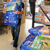 Joshua Perry carries Great Choice Adult Complete Nutrition dog food into the Enid SPCA Thursday, June 5, 2014. Park Avenue Thrift purchased the pet food at PetSmart and donated 25 bags to the Enid SPCA for their pet food pantry. Individuals, who are between pay periods, may request food once per month for their pets from the Enid SPCA food pantry. Vickie Grantz, executive director at Enid SPCA, said the food pantry furnished pet food for 287 families in 2013. (Staff Photo by BONNIE VCULEK)