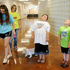 Children stand like trees with their arms by their sides and their faces toward the ceiling as Jaidyn McAdoo (left) leads Pistol around the students during a dog bite prevention class at Applewood Learning Center Wednesday, June 4, 2014. Northwestern Oklahoma State University Science Camp participants: McAdoo, Katelyn James, Macey Miller, Rachel Abraham Savannah Stavincha and Allen Schuchman assisted with the classes. (Staff Photo by BONNIE VCULEK)