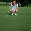 Aly Seng aligns a putt at Oakwood Country Club Thursday, June 12, 2014. Seng, who finished her general studies degree at the University of Central Oklahoma, returns to Enid as the new assistant golf pro at Oakwood Country Club. (Staff Photo by BONNIE VCULEK)