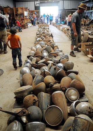 Rows of headlights and other car parts fill a large storage building during the Oliver Jordan car auction Saturday, June 7, 2014. (Staff Photo by BONNIE VCULEK)