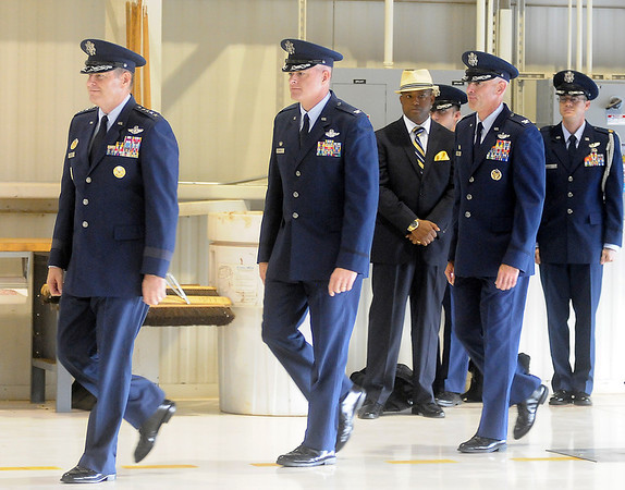 General Robin Rand, Col. Darren V. James and Col. Clark J. Quinn approach the stage before the official party takes their seats during the 71st Flying Training Wing Change of Command Wednesday, June 18, 2014 at Vance Air Force Base. Col. Quinn assumes command after Col. James 24-month command at the base. (Staff Photo by BONNIE VCULEK)