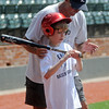 Scott Pendleton shows a young man the proper batting stance during the Enid baseball camp at David Allen Memorial Ballpark Tuesday, June 3, 2014. More than 160 youth, both boys and girls, will learn the fundamentals of baseball from 8:30-11:30 a.m. each day during the two week camp at David Allen Memorial Ballpark. Anyone interested in attending the camp may contact Bill Mayberry for more information. (Staff Photo by BONNIE VCULEK)