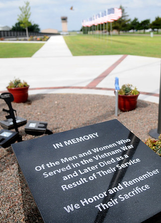 "A new ""In Memory"" granite marker, made by North American Stonecrafters, honors the men and women who served in the Vietnam War and later died as a result of their service at the Vietnam Memorial Wall during Flag Day Saturday, June 14, 2014. (Staff Photo by BONNIE VCULEK)"