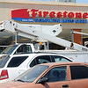 Jessie Kline exits a bucket lift as Kline Sign, LLC installs the new signage at Firestone Complete Auto Care Wednesday, June 11, 2014. The business located at 117 N. Washington is formerly Expert Tire. (Staff Photo by BONNIE VCULEK)