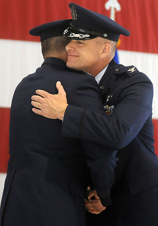 Col. Darren V. James (right) receives congratulations from Gen. Robin Rand after James was presented with the Legion of Merit during the 71st Flying Training Wing Change of Command Wednesday, June 18, 2014. Col. Clark J. Quinn assumed command during the ceremony. (Staff Photo by BONNIE VCULEK)
