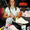 Aly Seng pauses inside the Pro Shop at Oakwood Country Club Thursday, June 12, 2014. After finishing her degree in general studies at the University of Central Oklahoma, Seng has returned to Enid as the new assistant golf pro at Oakwood Country Club. (Staff Photo by BONNIE VCULEK)