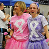 Teams applaud (left) as Kathi and Addi Shamburg (center) and other cancer survivors walk their victory lap around the Chisholm Trail Coliseum floor during Relay for Life Friday, June 6, 2014. Kathi is a breast cancer survivor and her daughter, Addi, is currently battling Hodgkin's lymphoma. The mother/daughter team were keynote speakers at the annual event. (Staff Photo by BONNIE VCULEK)