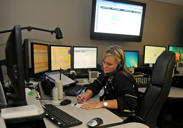 Jennifer Lawrence fields a 911 call at Enid Garfield County Major County 911 Communications in the Enid Police Department Wednesday, June 11, 2014. Within seconds, Lawrence sends emergency responders to the scene. Dispatchers use split ear listening to successfully do her job. (Staff Photo by BONNIE VCULEK)
