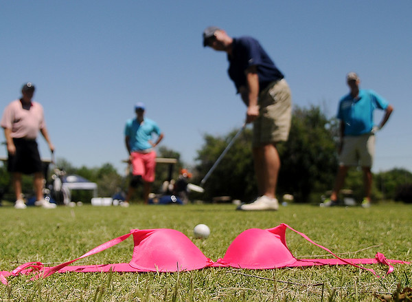 """Golfers """"Putt in a Cup"""" for Enid Community Clinic's free mammograms through Oklahoma Project Women during the 27th annual United Way Golf Tournament and Ronna Richards Memorial Fundraiser at Meadowlake Golf Course Friday, June 13, 2014. (Staff Photo by BONNIE VCULEK)"""