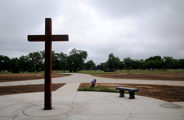 A large wooden cross adorns the southern edge of the Garden of Hope at Memorial Park Cemetery Thursday, June 5, 2014. The cemetery improvements will add about 3,000 spaces and two columbariums for cremations as part of the $1 million upgrade. (Staff Photo by BONNIE VCULEK)