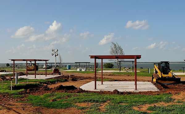 Construction of new campsite at the Canadian Recreation Area on Canton Lake June 21, 2014. The campground was destroyed by a tornado in May 2011. (Staff Photo by BILLY HEFTON)