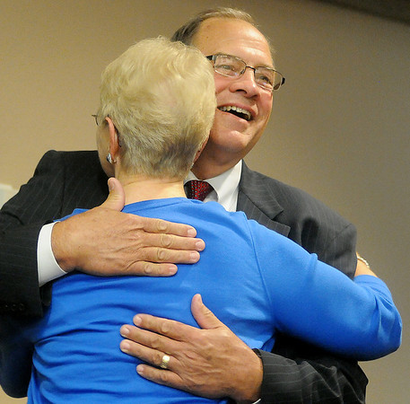Harold LeValley, from Braman, hugs one of his former middle school teachers at the City of Enid city commission boardroom Tuesday, June 10, 2014. LeValley, a candidate for District 38, took turns answering questions during a forum. (Staff Photo by BONNIE VCULEK)