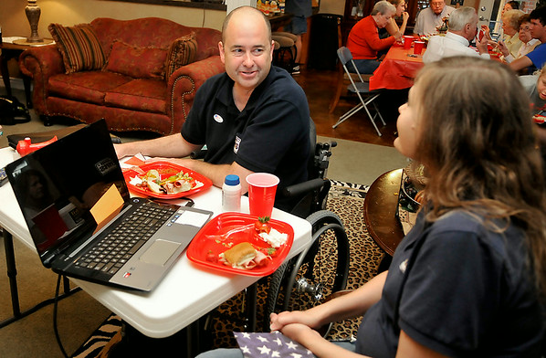 John Enns talks to his wike, Charla, during his Oklahoma House Dist. 41 watch party Tuesday. (Staff Photo by BILLY HEFTON)