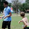 Sr. Airman Jesse Kow suffers a direct water balloon hit from Camp Tomahawk participants during games at the Vance Air Force Base park Thursday, June 5, 2014. Activities throughout the week include a trip to Frontier City, Alabaster Caverns, games and cookouts. The week-long event is sponsored by the Greater Enid Chamber of Commerce. (Staff Photo by BONNIE VCULEK)