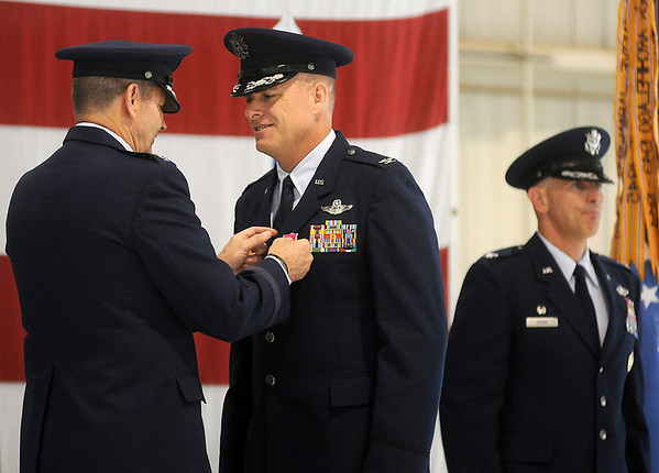 Gen. Robin Rand presents Col. Darren V. James with the Legion of Merit during the 71st Flying Training Wing Change of Command at Vance Air Force Base Wednesday, June 18, 2014. Col. Clark J. Quinn assumed command during the ceremony. (Staff Photo by BONNIE VCULEK)