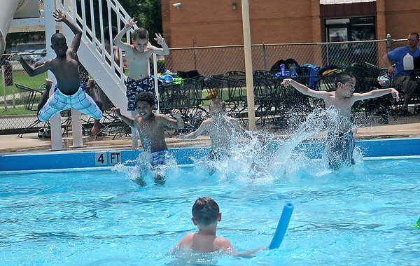 Greater Enid Chamber of Commerce Camp Tomahawk participants leap  into the Vance Air Force Base pool Thursday, June 5, 2014. Activities include trips to Frontier City, Alabaster Caverns, water activities and cookouts during the week-long event. (Staff Photo by BONNIE VCULEK)