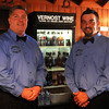 Dagan Hardin (left) and his nephew, Zach Hardin, are two of the founders of Vernost Wine at 110 N. Main in Hennessey. Business owners Wes Hardin, Hardin and Hardin welcomed guests to their grand opening Friday, June 6, 2014. (Staff Photo by BONNIE VCULEK)