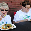 """Tossed"" judges, Barb Benson and Kayte Anton (from left) sample Ebby Stratton's dish during the first round of competition at Enid Farmers Market Saturday, June 21, 2014. (Staff Photo by BONNIE VCULEK)"