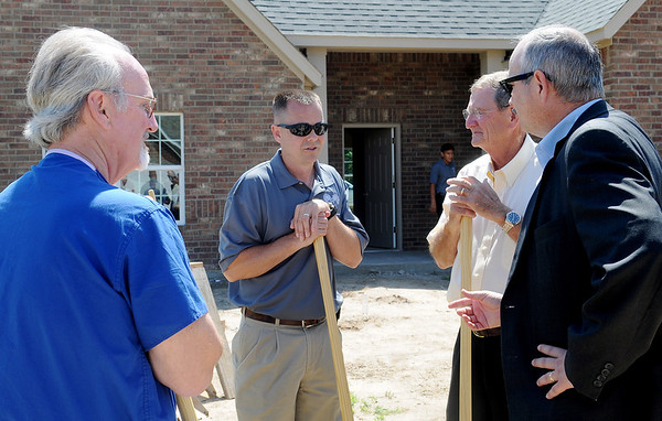 Lance Windell (center), with Milestone Homes, discussses phase II of the Tara Estates expansion following the groundbreaking ceremony Wednesday, June 11, 2014. Four new homes are currently under construction and 31 additional lots for single family homes are available. (Staff Photo by BONNIE VCULEK)