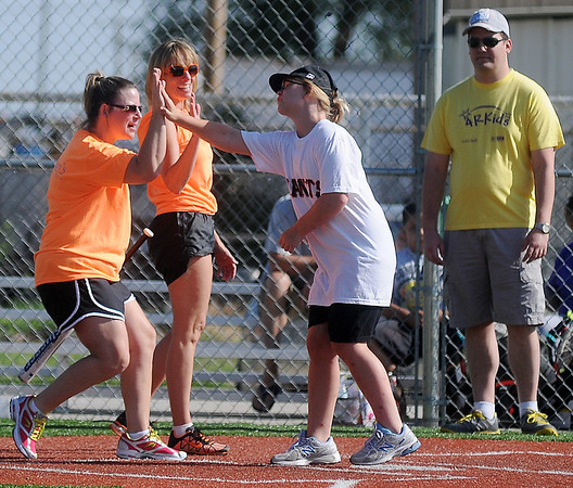 St. Mary's Regional Medical Center buddies (left) high-five Mimi Glasgow as she scores for the Giants during the 4RKids Miracle League games at AMBUCS ABC Park Saturday, June 21, 2014. (Staff Photo by BONNIE VCULEK)