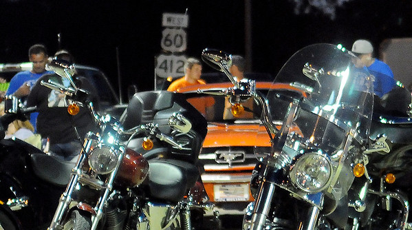 Motorcycles and muscle cars appear near the Van Buren and Owen K. Garriott intersection during Van Buren Cruisers' events Friday, June 13, 2014. (Staff Photo by BONNIE VCULEK)