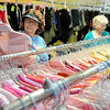 Keitha Kukuk and Wilma Ridgway (from left) shop for clothing at Park Avenue Thrift Friday, June 13, 2014. (Staff Photo by BONNIE VCULEK)