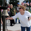 "Karen Vollman rings a bell as she remembers her late husband, U. S. Navy Seaman Richard David Vollman, during the Unsung Hero ""In Memory"" Ceremony on Flag Day at the Vietnam Memorial Wall and Woodring Wall of Honor Veterans Park Saturday, June 14, 2014. Vollman was a Navy mechanic during the Vietnam War and died in August 2002, of leukemia at the age of 52. The service honored men and women who died indirectly from their service in Vietnam. (Staff Photo by BONNIE VCULEK)"