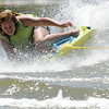 Zoey Melvin laughs as she tumbles off a zup board during In His Wakes activities at Ski Ranch Wednesday, June 25, 2014. (Staff Photo by BONNIE VCULEK)