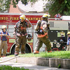 Enid firefighters respond to a structure fire at 324 W. Pine Saturday, June 21, 2014. (Staff Photo by BONNIE VCULEK)