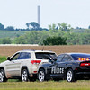 A Waukomis police officer makes a traffic stop on US 81 June 25, 2014. (Staff Photo by BILLY HEFTON)