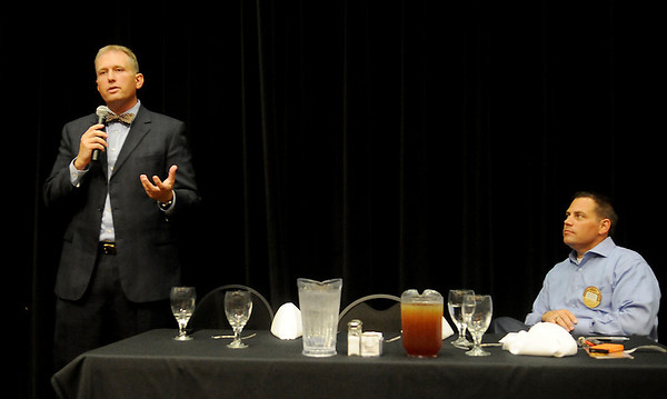 Chad Caldwell (left) and Mike Stuber (right) take turns answering questions during an Oklahoma House District 40 candidate forum at Enid Noon AMBUCS' luncheon in the Northern Oklahoma College-Enid Gantz Center ballroom Friday, June 6, 2014. (Staff Photo by BONNIE VCULEK)