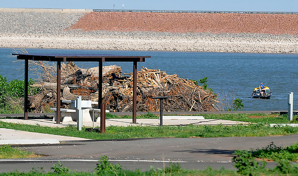 A new campsite built near a pile of debris at the Canadian Recreation Area on Canton Lake June 21, 2014. The cmapground was destroyed by a tornado in May 2011. (Staff Photo by BILLY HEFTON)