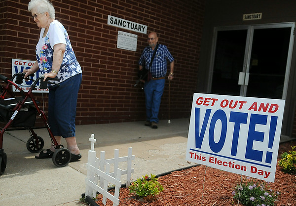 Voters leave Redeemer Lutheran Church after casting their ballots during the Oklahoma Primary Election Tuesday, June 24, 2014. (Staff Photo by BONNIE VCULEK)