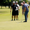 Golfers putt on the No. 9 green during the 27th annual United Way Golf Tournament and Ronna Richards Memorial Fundraiser at Meadowlake Golf Course Friday, June 13, 2014. More than 100 participated in the one-day event. (Staff Photo by BONNIE VCULEK)