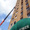 Sheet rock hangs above the entrance to Broadway Tower as interior remodeling continues Tuesday, June 3, 2014. (Staff Photo by BONNIE VCULEK)