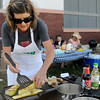 "Ebby Stratton grills yellow squash, mushrooms and onions during the first ""Tossed"" competition at Enid Farmers Market Saturday, June 21, 2014. Stratton, Kathy Reihm and Randy Wedel prepared an entree in one hour before the judging began. (Staff Photo by BONNIE VCULEK)"