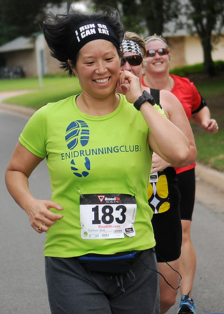 "Eve Switzer sprints across the finish line at the ""Saints on the Go"" 5K Saturday, June 14, 2014. Proceeds from the event support St. Joseph Catholic School activities. (Staff Photo by BONNIE VCULEK)"