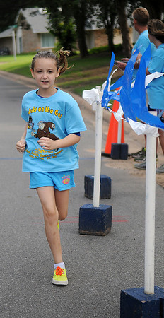 """Lilly Vculek finishes the """"Saints on the Go"""" 5K Saturday, June 14, 2014. Proceeds from the run support St. Joseph Catholic School activities. (Staff Photo by BONNIE VCULEK)"""