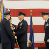 General Robin Rand (left), Commander, Air Education and Training Command, Joint Base San Antonio-Randolph, Texas, presents the 71st Flying Training Wing colors to Colonel Clark J. Quinn during the Change of Command ceremony at Vance Air Force Base Wednesday, June 18, 2014. Col. Darren V. James (right), who served as the 71st Flying Training Wing commander the past 24 months, was presented the Legion of Merit by General Robin Rand during the ceremony. (Staff Photo by BONNIE VCULEK)