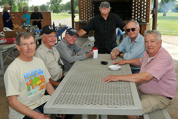 (left to right) Herb Hagenau, Butch Coltrane, Derel Schrock, Fred Wisely, Jerry Ward and Bob Taylor sit for a group photo during a 50th reunion of their pilot training class at Vance Air Force Base. (Staff Photo by BILLY HEFTON)