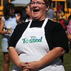"Kathy Reihm reacts as she wins the ""Tossed"" vegetarian meal challenge at Enid Farmers Market Saturday, June 21, 2014. (Staff Photo by BONNIE VCULEK)"